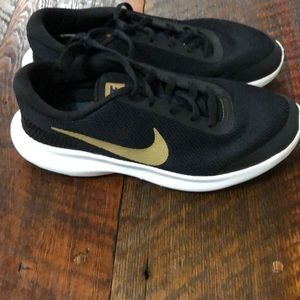 EUC, Nike black and gold shoes, women's size 6.5